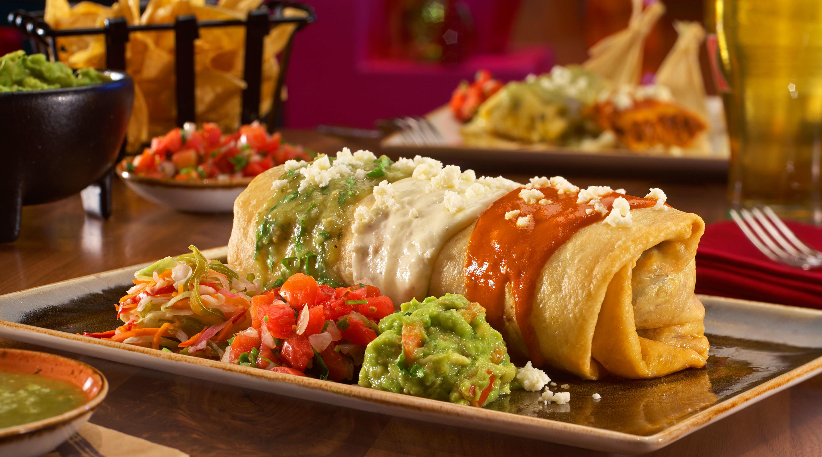 Burrito Banderas style service with pico de gallo, crema and guacamole at Hecho en Vegas.