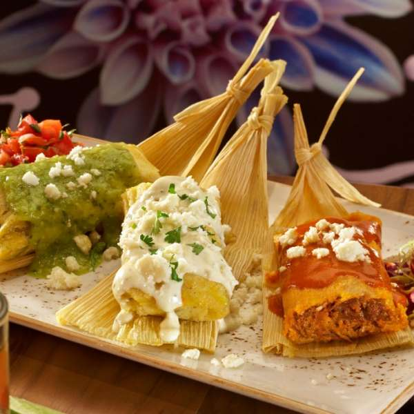 Tamale Temptation is a tasting trip of chicken tomatillo, fresh corn and beef tamales at Hecho en Vegas.
