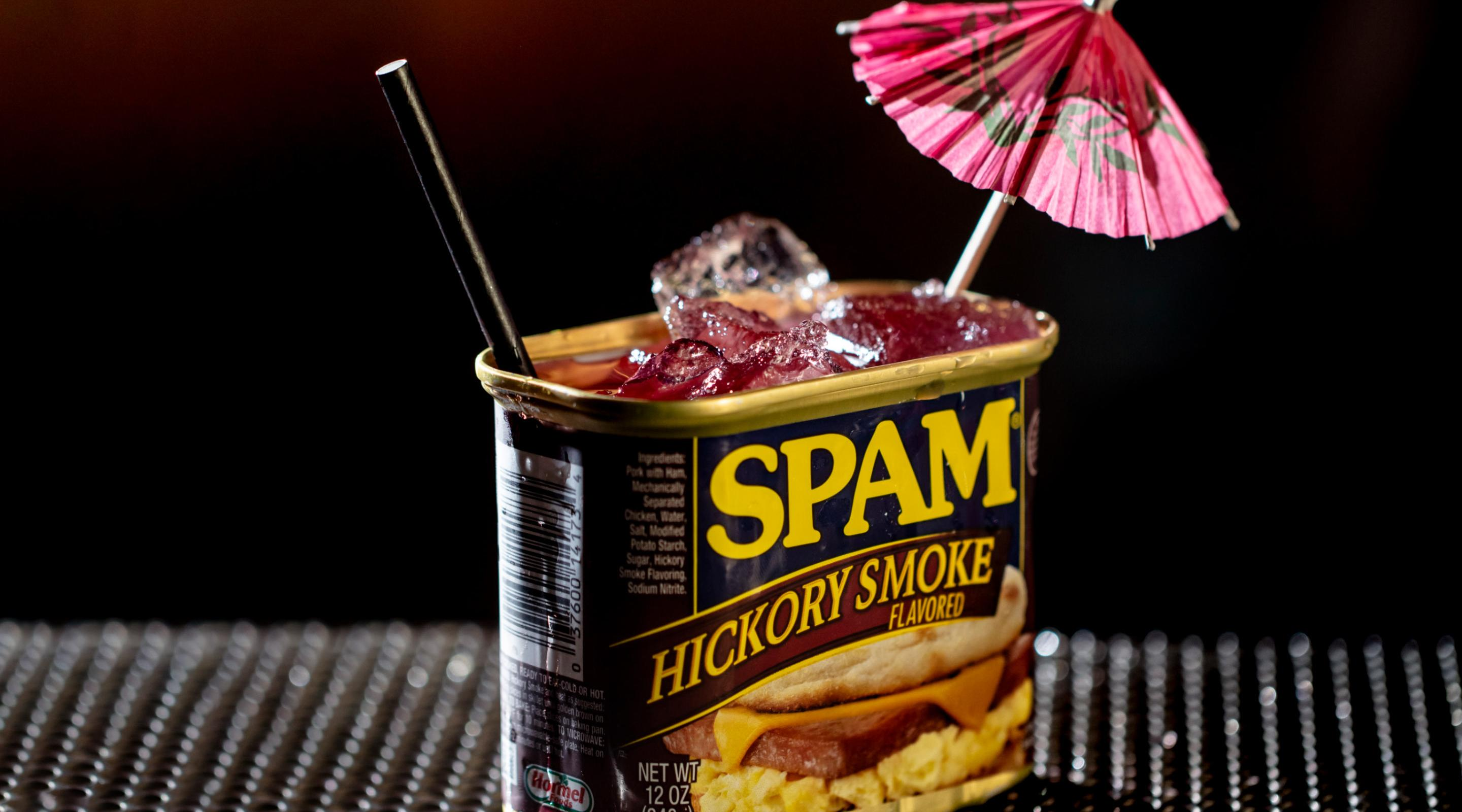 A cocktail with the Spam can on the bar.