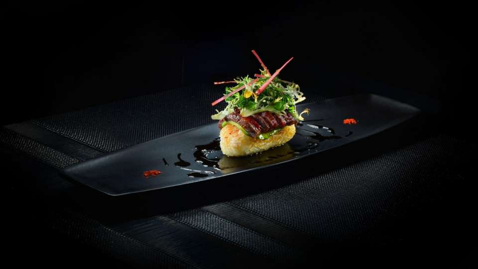 L'Atelier de Joël Robuchon features a unique counter service where your dinner is prepared right before your eyes.