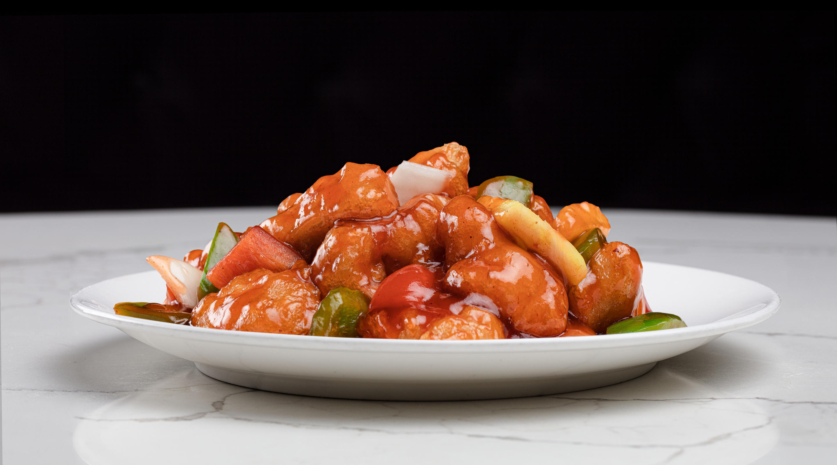 A plate of sweet and sour chicken from Grand Wok.