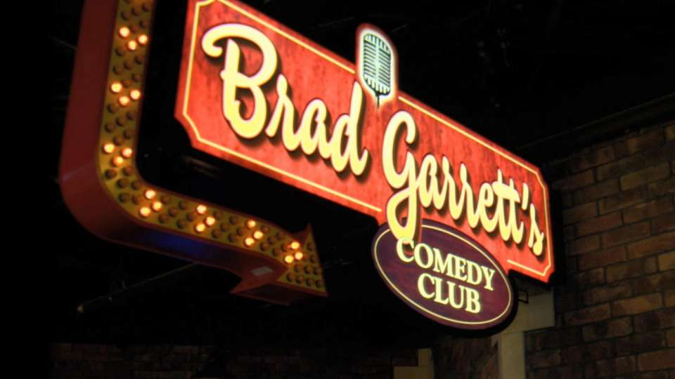 A close up of the Brad Garrett's Comedy Club Sign.