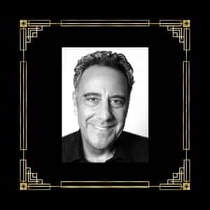 A picture of Brad Garrett in a marquee frame with a red curtain in the background.