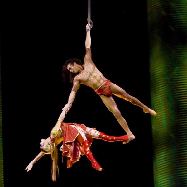 The Firefly Boy glides and dives as he performs aerial acrobatics and makes a special connection, in an aerial duet, with the Twin Sister after she plummets from the flying bird into his world.