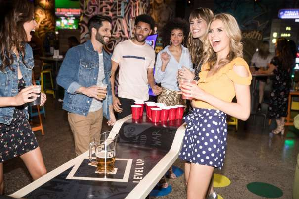 Image of a younger crowd playing beer pong at Level Up.