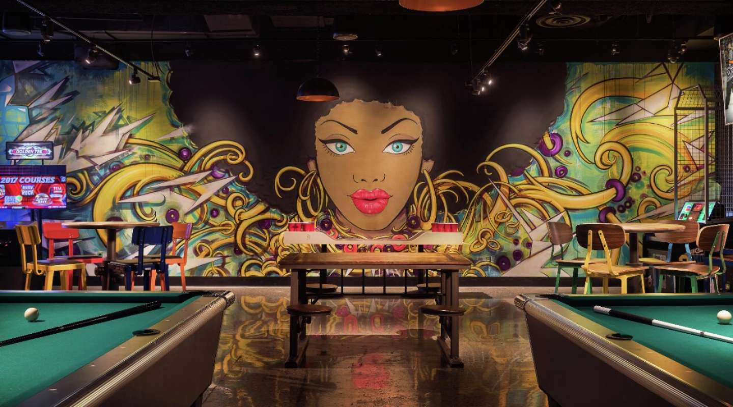 Mural and gaming area at Level Up inside MGM Grand.