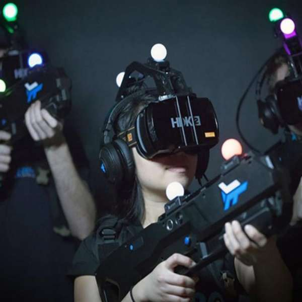 Three gamers prepared to play a virtual reality game by Zero Latency at Level Up in the MGM Grand Las Vegas.