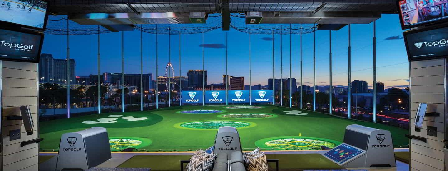 The interior of Topgolf with a field view.