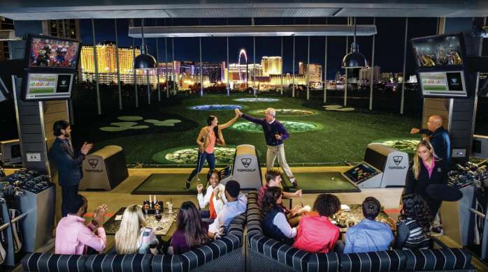 Topgolf double bay lifestyle shot with The Strip in the background