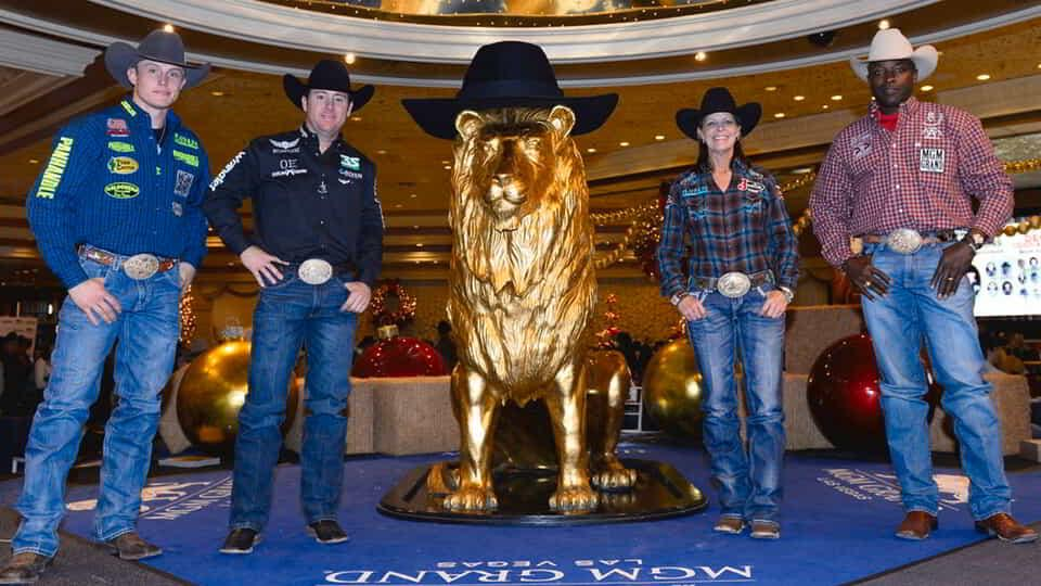 Riders from National Finals Rodeo in lobby with MGM Grand Lion.