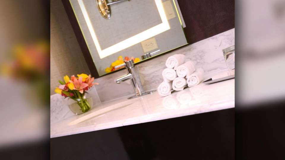 Our bathrooms are adorned with modern fixtures that provide a place to refresh in Vegas.