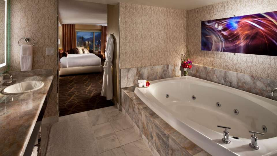 The Penthouse City View suite boasts an oversized Roman spa tub and separate shower.