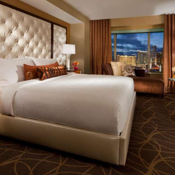 Get glittering views of the Strip from the private bedroom.