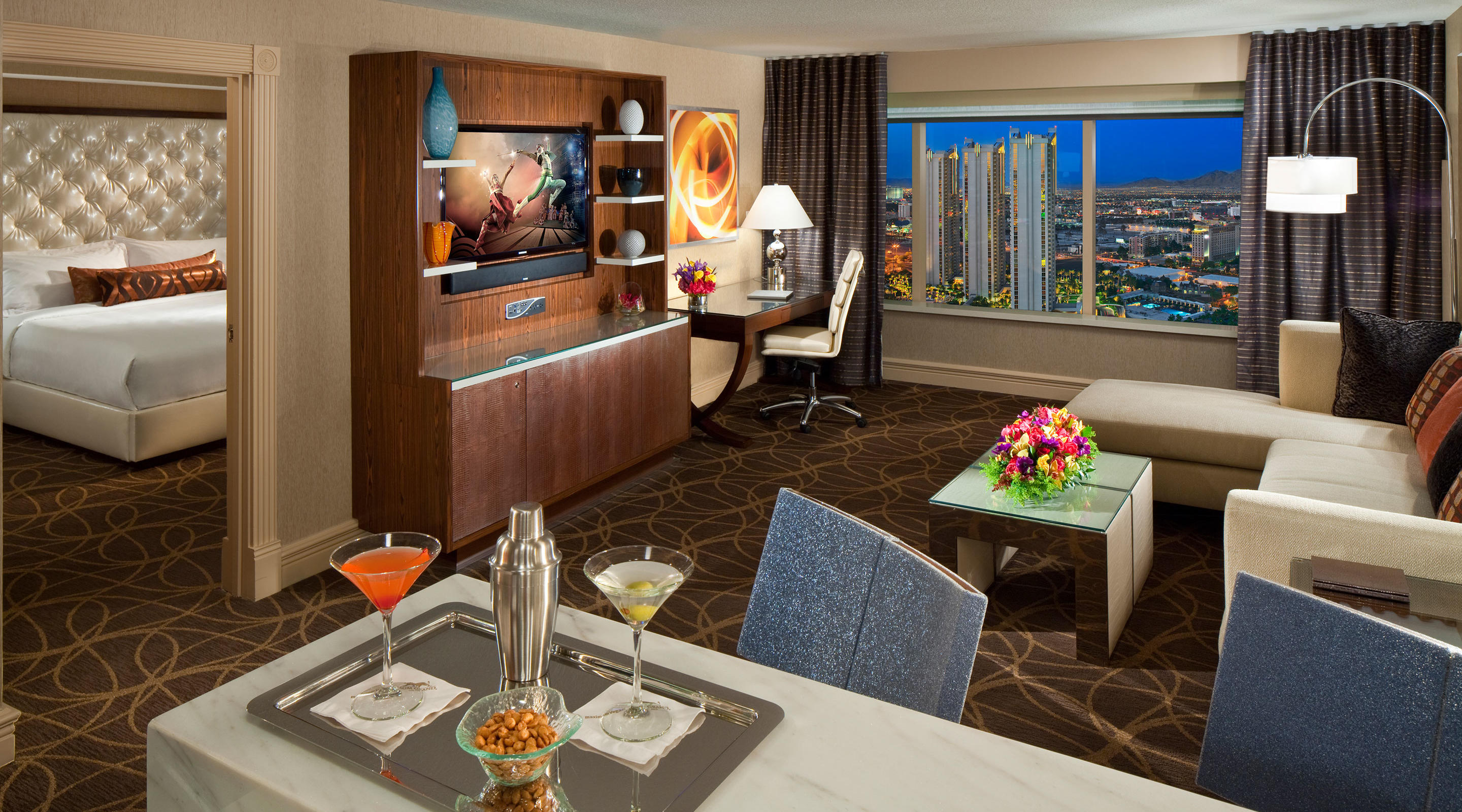 This inspiring suite boasts an oversized marble bar with bar-style seating and a separate dining area for four.