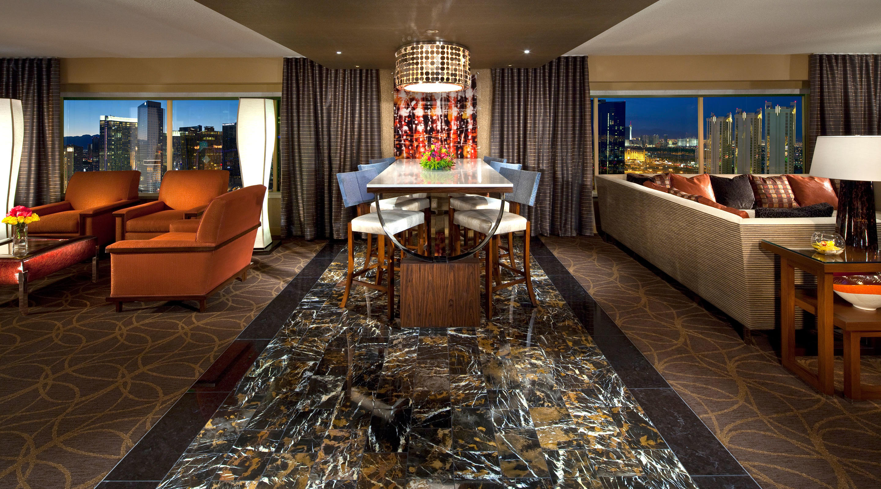 This expansive suite opens to a grand foyer and breathtaking panoramic views of the Strip.