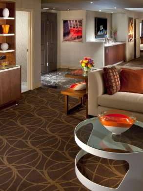 This spectacular suite features an extended living room, dining table for six, over-sized marble bar.