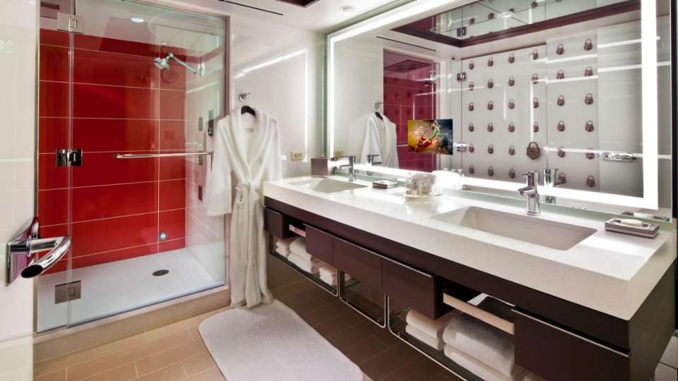 The modern master bath features a make-up vanity, dual sinks, an oversized whirlpool tub and separate shower.