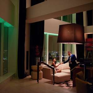 mgm-grand-hotel-skylofts-living-room-couple-with-drinks-x2.jpg.image.300.300.high