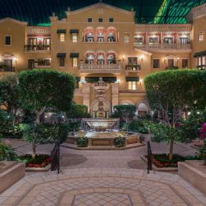 mgm-grand-hotel-rooms-mansion-exterior-atrium-night-light-water-fountain-hero-shot-@2x.jpg.image.300.300.high
