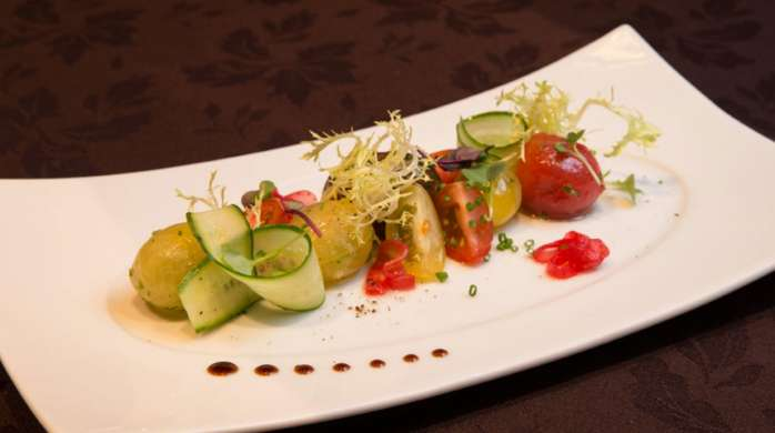 Stay Well  Summer Heirloom Tomato Salad available on the Stay Well Meetings Catering Menu at MGM Grand