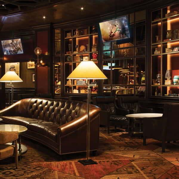 Wide angle shot of leather couches and tables inside Whiskey Down