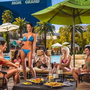 mgm-grand-pool-lifestyle-tropic-beauty-group-cabana-wide-@2x.jpg.image.300.300.high