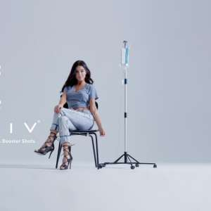 mgm-grand-amenities-reviv-wellness-girl-with-iv-reviv-logo.jpg.image.300.300.high