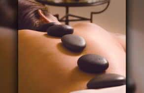 Woman getting a hot stone massage at the Grand Spa inside the MGM Grand