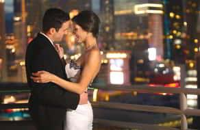Bride and Groom slow dancing in one of the balconies in the Skyline Terrace Suite at MGM Grand