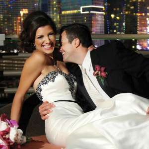 Bride and Groom sitting on the balcony of the Skyline Terrace Suite at MGM Grand