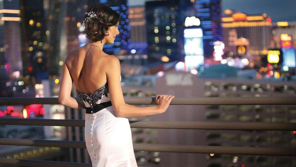 Bride overlooking the Las Vegas Strip scenery from the balcony of the Skyline Terrace Suite at MGM Grand
