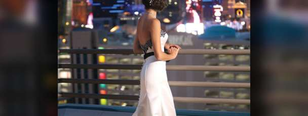 Bride overlooking the Las Vegas Strip from the balcony of the Skyline Terrace Suite at MGM Grand