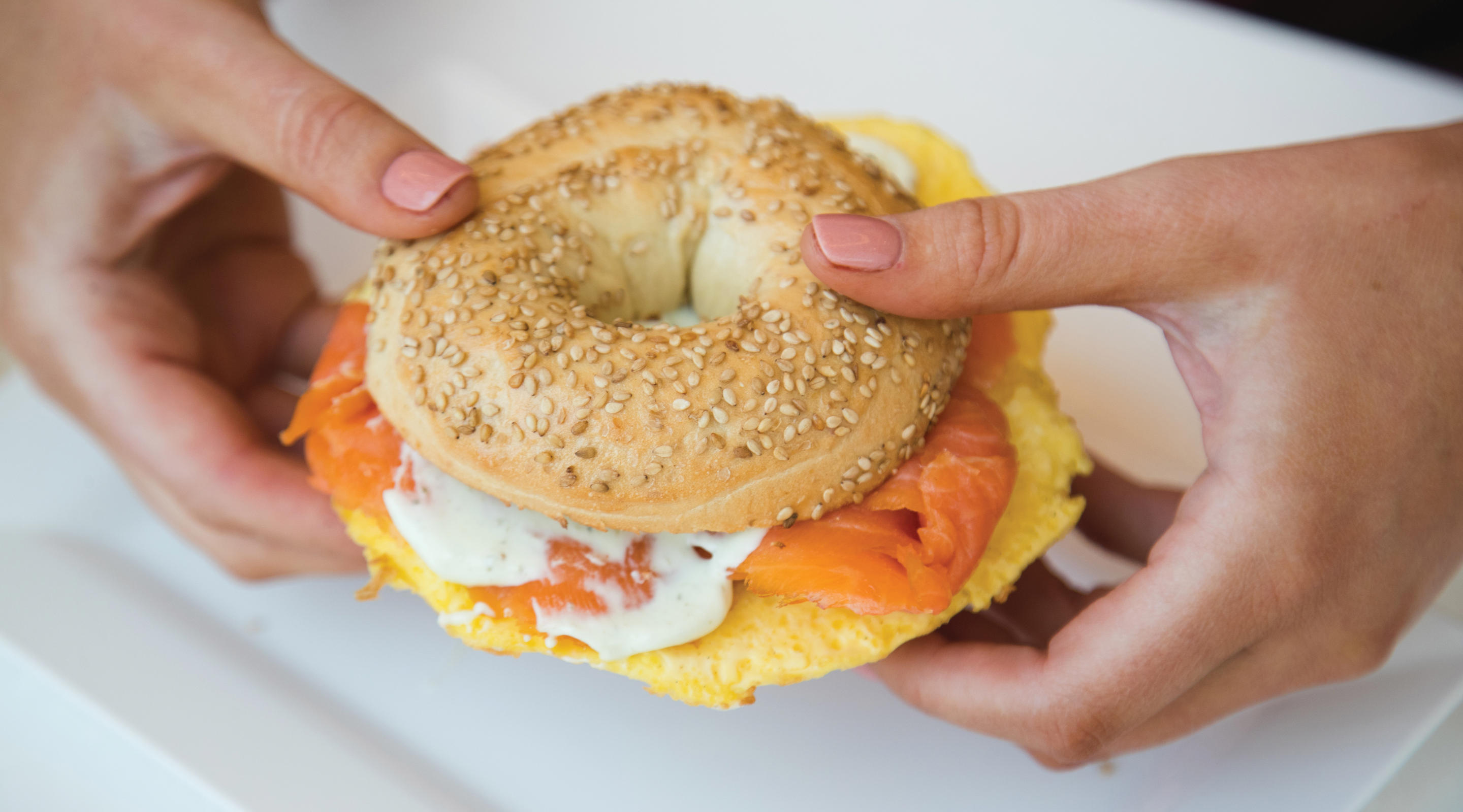 Lox and egg on a sesame seed bagel.