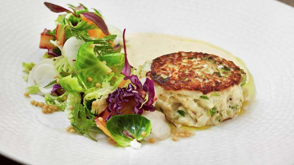 Try the crab cakes at Fish by José Andrés.