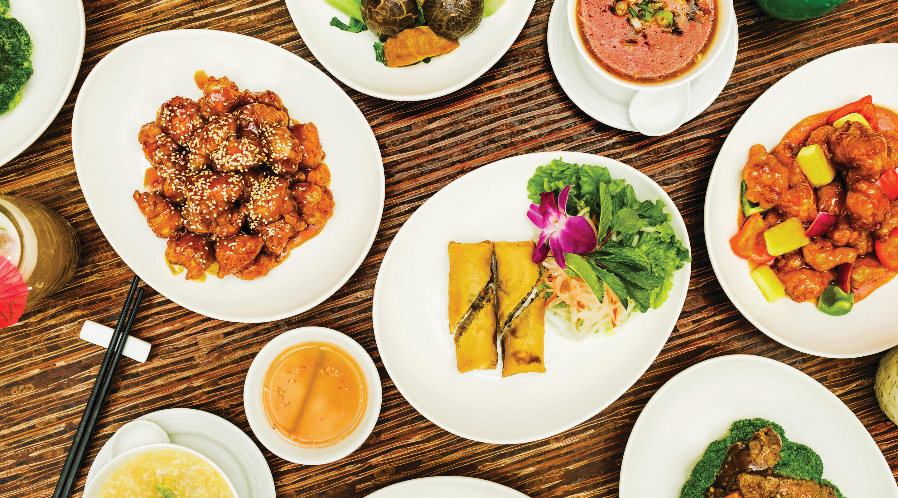 A table spread of main course dishes at Ginger.