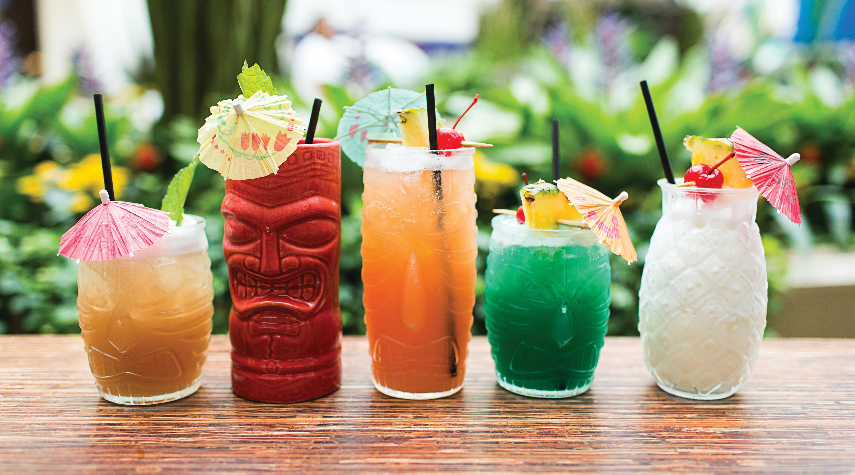 Various Tiki drinks on a bar at Ginger.