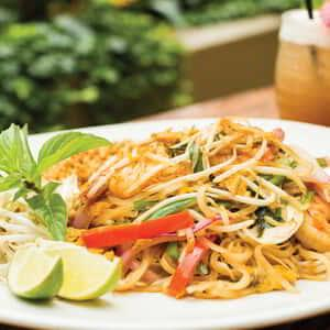 A plate of wok tossed Noodles featured at Ginger.