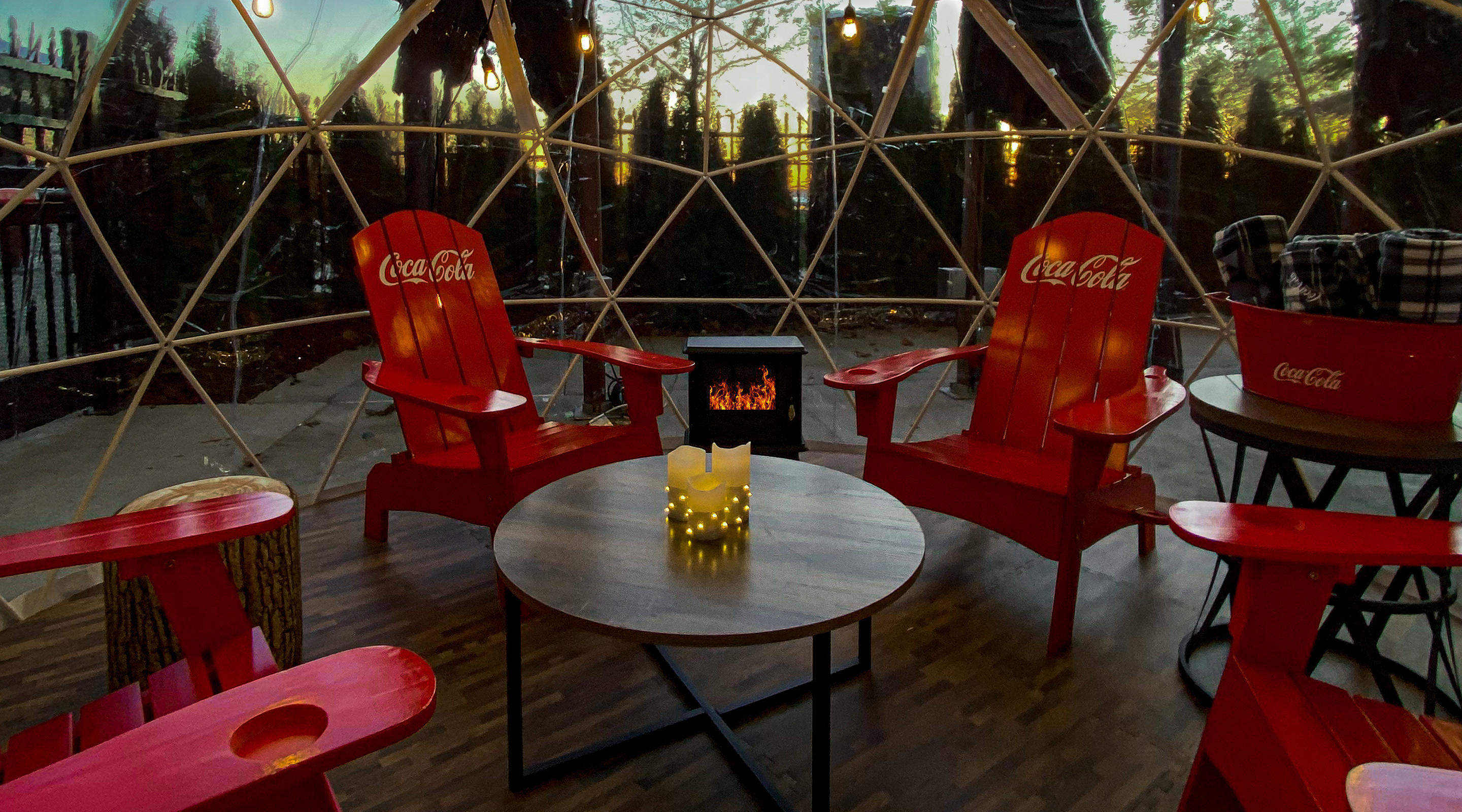 Dine outdoors in the COCA-COLA® snow globes at TAP.