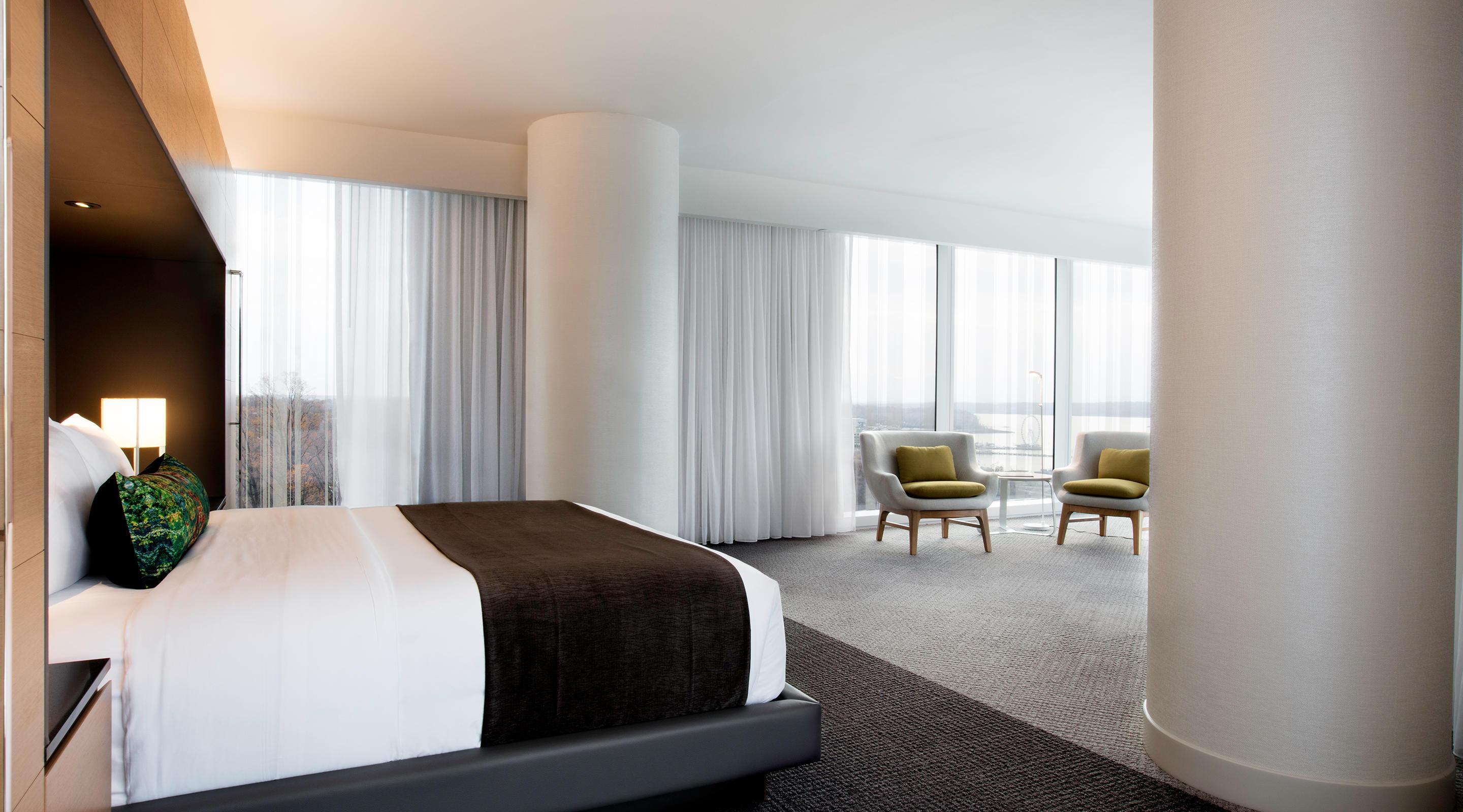 Floor to ceiling windows accent our the luxurious Corner Suite.