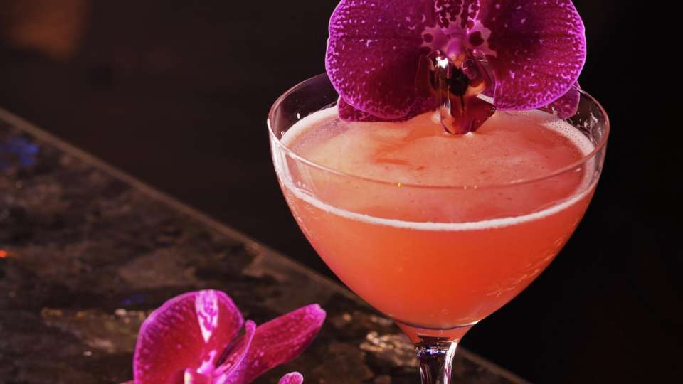 Experience cocktail mastery at Blossom Lounge.