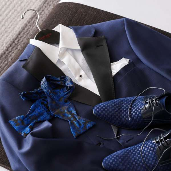 Matching blue suit, bowtie and shoes.