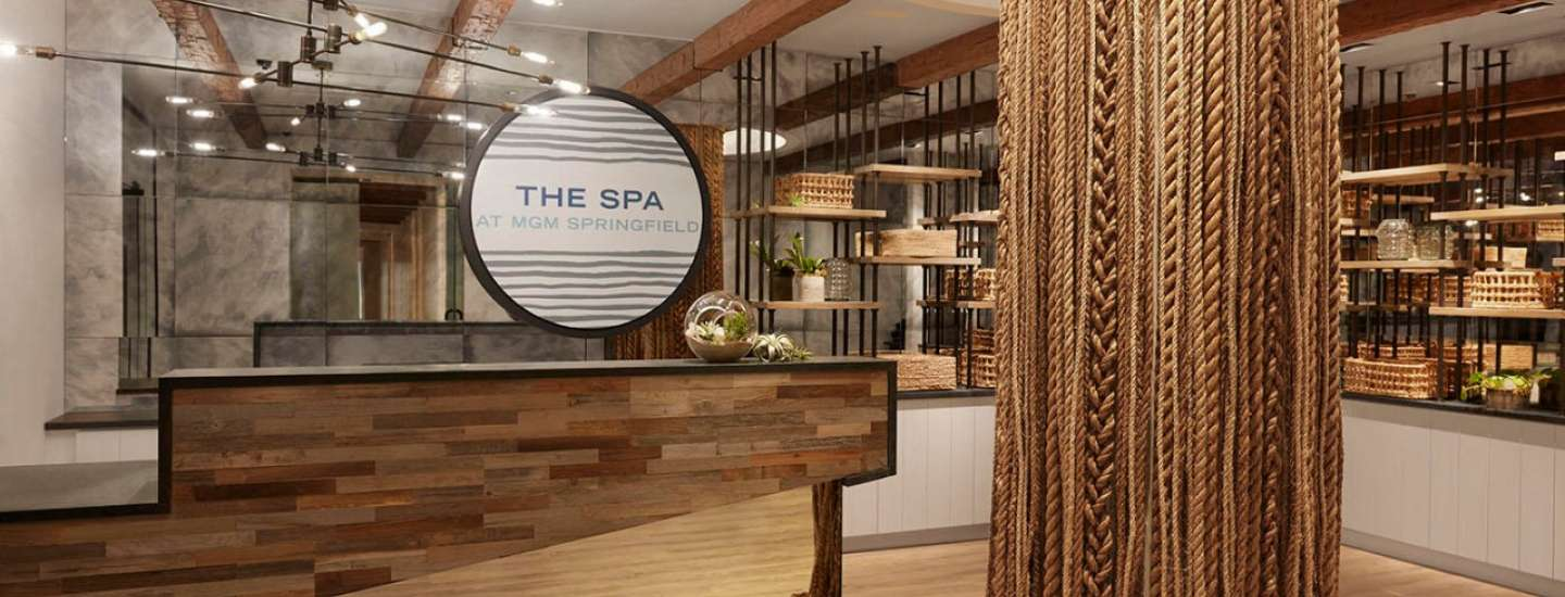 Spa front desk with braided rope decor.