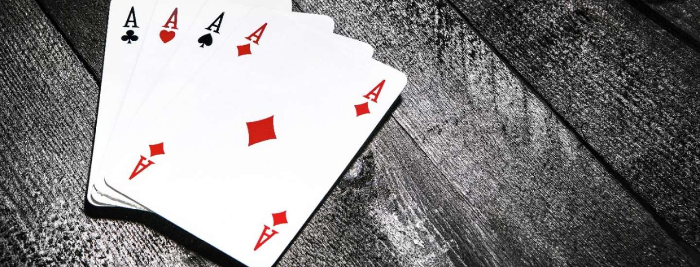 Four cards spread on a table.