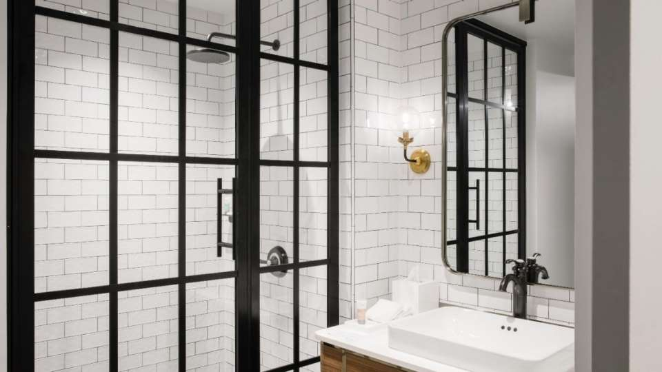 White subway tiles wrap around the walls.