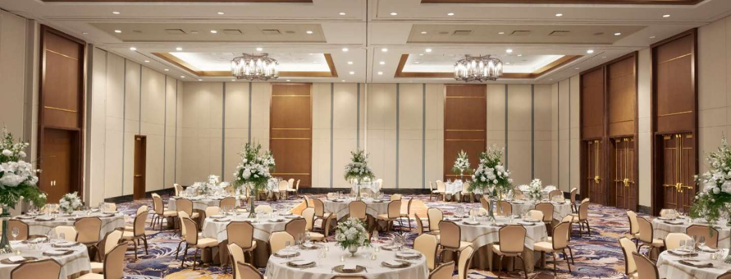 Beautiful banquet space set up in traditional banquet style.