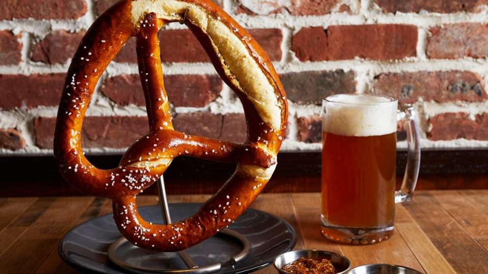 Our giant pretzel hangs from a banana stand.