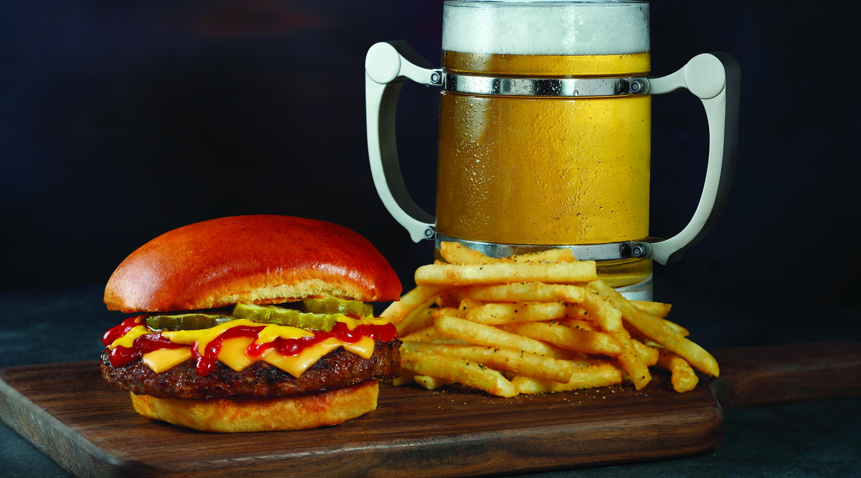 Beer stein with burger and fries from Tom's Urban.