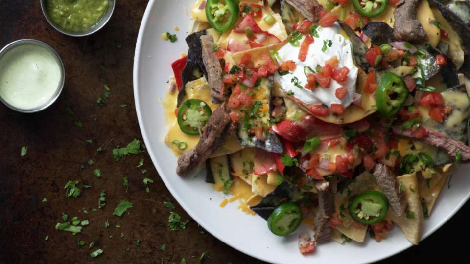Indulge at Tom's Urban with our nachos platter!