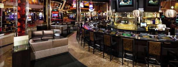Step into the Center Bar, located in the heart of New York-New York's casino floor.
