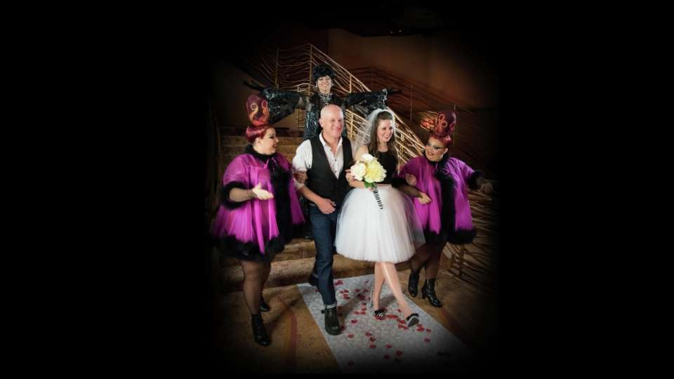 Zumanity Weddings couple leaving with twins.